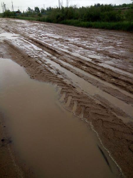 Размытый участок дороги в мкр. Кадалинка